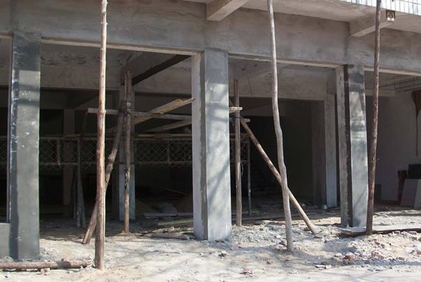 河南门面改造是怎样计算钢筋混凝土梁的极限荷载的?