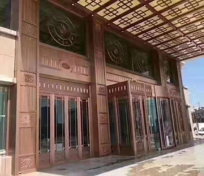 岳阳中奥名珠旋转玻璃纯铜门工程
