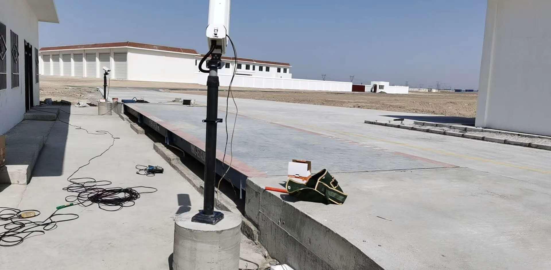 新疆坤宁衡器设备有限公司承接的甘肃玉门80吨数字地磅一台、无人值守称重系统一套安装调试好