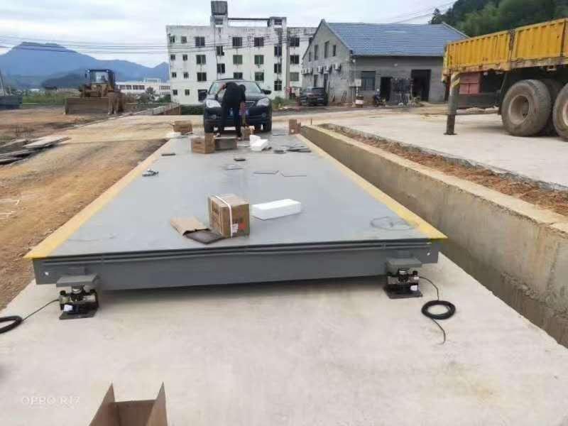 建瓯炎鑫环保有限公司建瓯总公司3x18米120吨地磅安装。