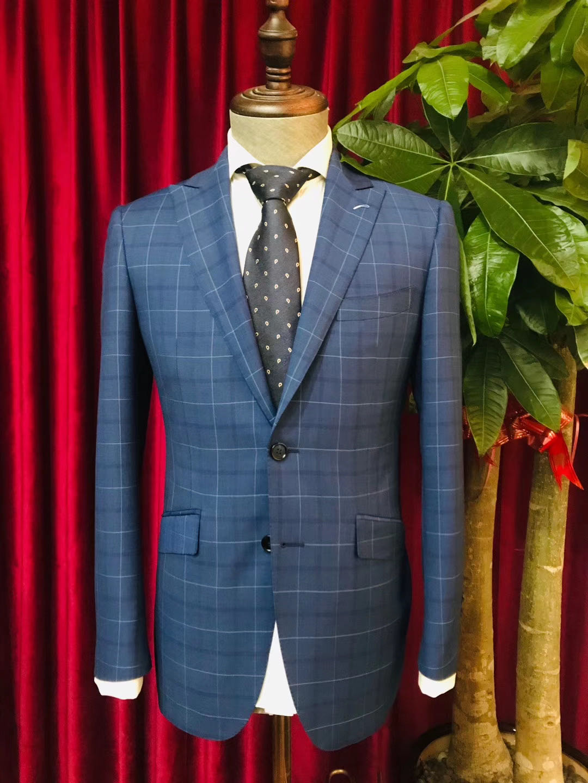 格纹西装定制如何搭配出绅士感?