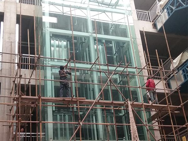 甘肃兰州市安宁区华尊利达B区观光电梯点式幕墙工程