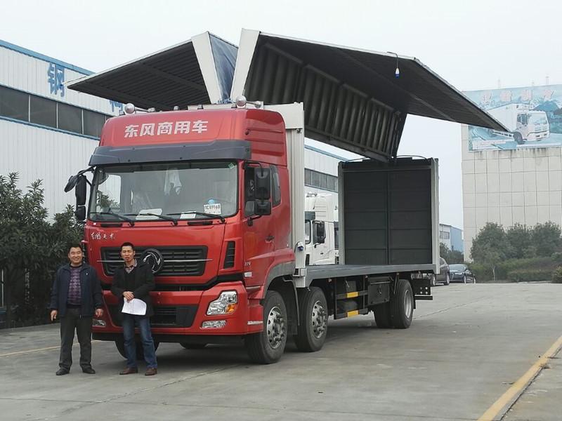 东风天龙前四后四13.38吨9.6米翼开启厢式车