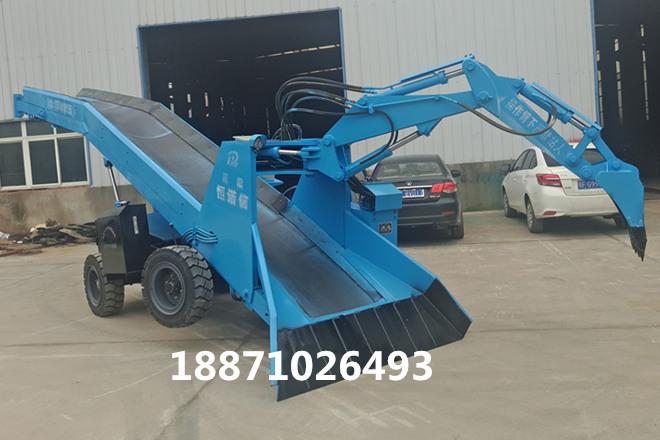 轮式爬渣机输送带承载着将碎渣石传送到出碴车上