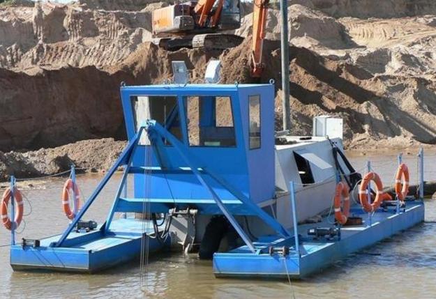 淘金船是沙金生产的先进采选联合设备