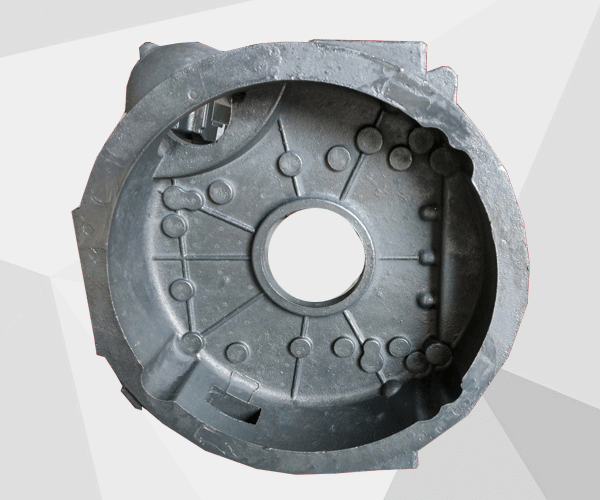What is the reason for the cracking of the flywheel housing of heavy duty trucks?