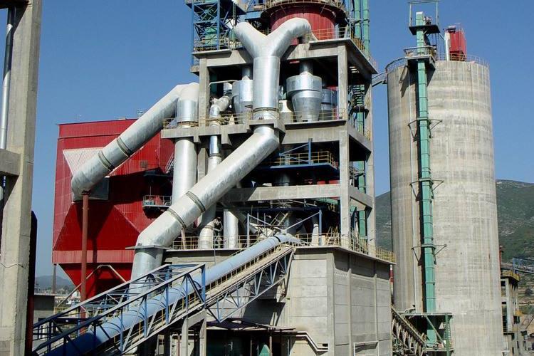 磁力声能清灰器在预热器五级下料管上的应用