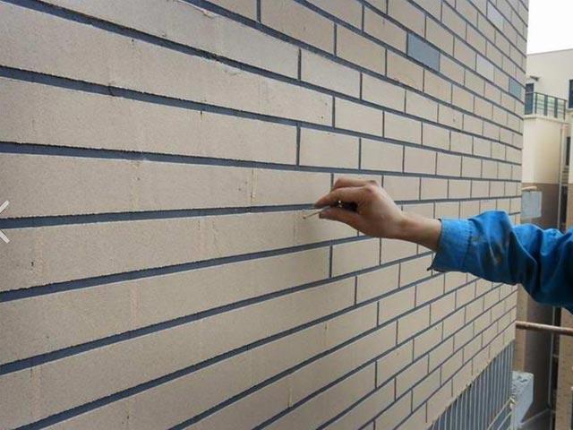建筑外墙真石漆为什么大量掉皮?
